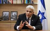 Opposition leader Yair Lapid of Yesh Atid-Telem is pictured during an interview with AFP at his office in the Knesset, Jerusalem, on September 14, 2020. (Emmanuel Dunand/AFP)