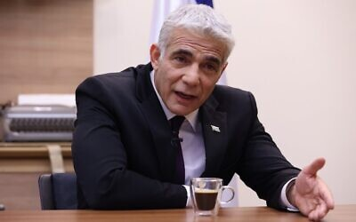 Opposition leader Yair Lapid of Yesh Atid-Telem at his office in the Knesset, Jerusalem, on September 14, 2020. (Emmanuel Dunand/AFP)