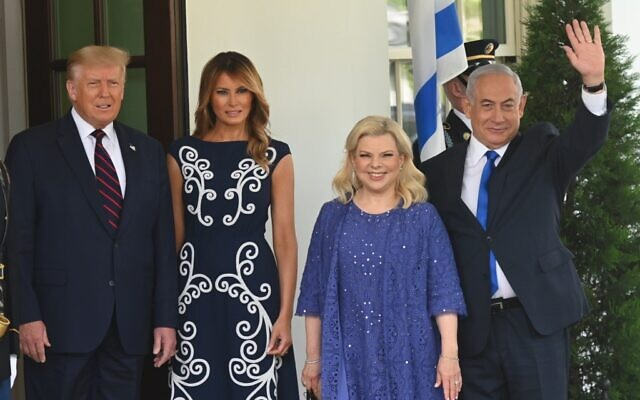 US President Donald Trump (L) and First Lady Melania Trump welcome the arrival of Prime Minister Benjamin Netanyahu (R) and his wife, Sara, on the North Lawn of the White House in Washington, DC on September 15, 2020. (Andrew CABALLERO-REYNOLDS / AFP)