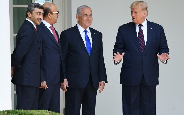 US President Donald Trump (R) with UAE Foreign Minister Abdullah bin Zayed Al-Nahyan (L), Bahrain Foreign Minister Abdullatif al-Zayani (2-L) and Israeli Prime Minister Benjamin Netanyahu (C) pose for pictures in the colonnade at the White House before the signing of the Abraham Accords where the countries of Bahrain and the United Arab Emirates recognize Israel, in Washington, DC, September 15, 2020 (SAUL LOEB / AFP)