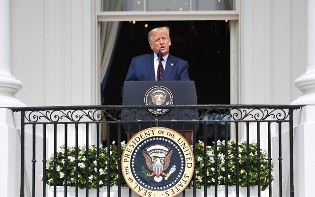 US President Donald Trump speaks from the Truman Balcony at the White House during the signing ceremony of the Abraham Accords where the countries of Bahrain and the United Arab Emirates recognize Israel, on the South Lawn of the White House in Washington, DC, September 15, 2020.(SAUL LOEB / AFP)