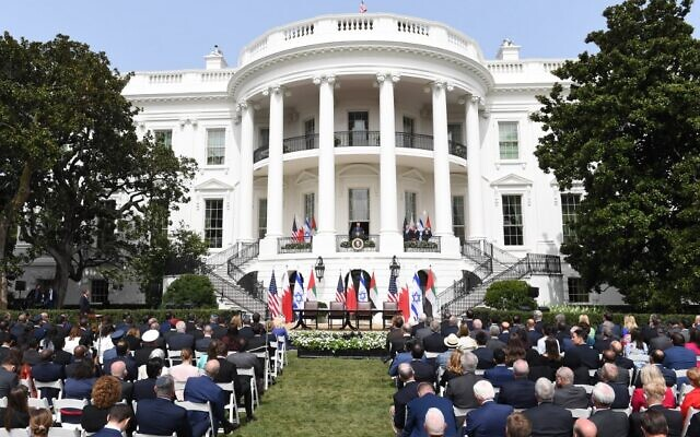 An audience watches as US President Donald Trump speaks from the Truman Balcony at the White House during the signing ceremony of the Abraham Accords where the countries of Bahrain and the United Arab Emirates normalize ties with Israel, on the South Lawn of the White House in Washington, DC, September 15, 2020 (SAUL LOEB / AFP)