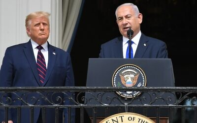 US President Donald Trump watches as Israeli Prime Minister Benjamin Netanyahu (R) speaks from the Truman Balcony at the White House during the signing ceremony of the Abraham Accords where the countries of Bahrain and the United Arab Emirates recognize Israel, on the South Lawn of the White House in Washington, DC, September 15, 2020. (Photo by SAUL LOEB / AFP)