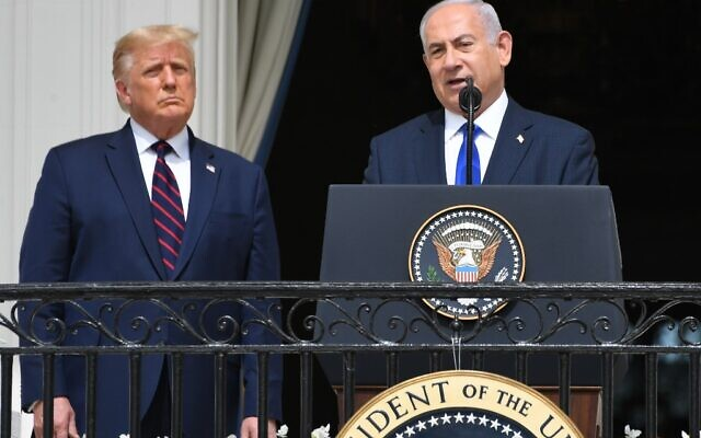 US President Donald Trump watches as Israeli Prime Minister Benjamin Netanyahu (R) speaks from the Truman Balcony at the White House during the signing ceremony of the Abraham Accords where the countries of Bahrain and the United Arab Emirates recognize Israel, on the South Lawn of the White House in Washington, DC, September 15, 2020 (SAUL LOEB / AFP)
