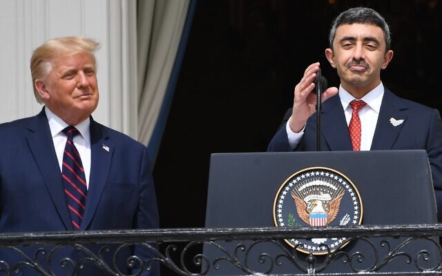 US President Donald Trump watches as UAE Foreign Minister Abdullah bin Zayed Al-Nahyan (R) speaks from the Truman Balcony at the White House during the signing ceremony of the Abraham Accords, on the South Lawn of the White House in Washington, DC, September 15, 2020. (SAUL LOEB / AFP)