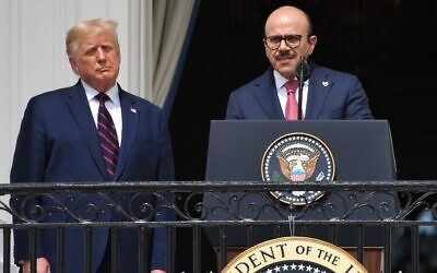 US President Donald Trump watches as Bahrain Foreign Minister Abdullatif al-Zayani speaks from the Truman Balcony at the White House during the signing ceremony of the Abraham Accords, September 15, 2020. (SAUL LOEB / AFP)