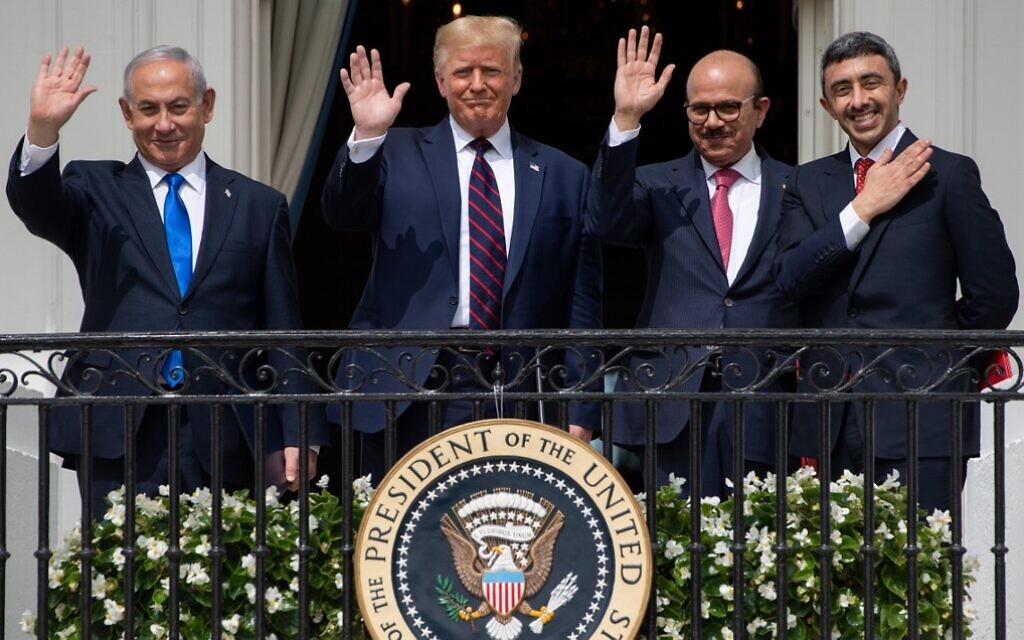 Israeli Prime Minister Benjamin Netanyahu, US President Donald Trump, Bahrain Foreign Minister Abdullatif al-Zayani, and UAE Foreign Minister Abdullah bin Zayed Al-Nahyan wave from the Truman Balcony at the White House after they participated in the signing of the Abraham Accords, where the countries of Bahrain and the United Arab Emirates recognize Israel, in Washington, DC, September 15, 2020. (SAUL LOEB / AFP)