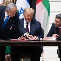Israeli Prime Minister Benjamin Netanyahu, US President Donald Trump, and UAE Foreign Minister Abdullah bin Zayed Al-Nahyan smile as they participate in the signing of the Abraham Accords at the White House on September 15, 2020. (SAUL LOEB / AFP)