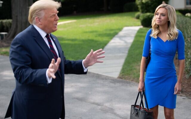 US President Donald Trump speaks alongside White House Press Secretary Kayleigh McEnany prior to departing on Marine One from the South Lawn of the White House in Washington, DC, September 15, 2020, as he travels to Philadelphia,  (SAUL LOEB / AFP)