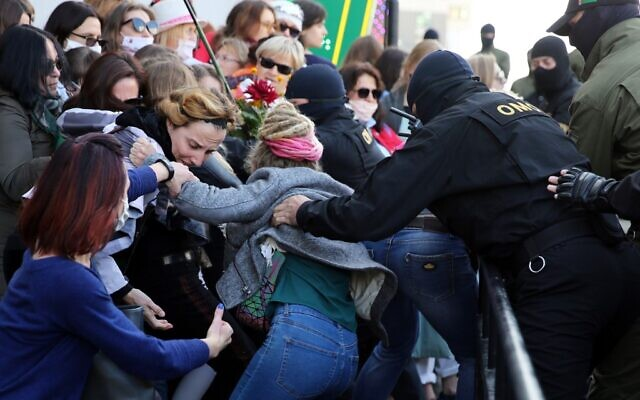 Law enforcement officers scuffle with women demonstrators during a rally to protest against the Belarus presidential election results in Minsk on September 19, 2020. (TUT.BY / AFP)