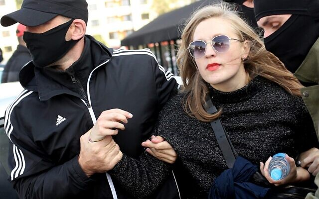 Law enforcement officers detain a woman during a rally to protest against the Belarus presidential election results in Minsk on September 19, 2020. (TUT.BY / AFP)