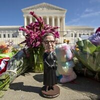 A bobblehead of Ruth Bader Ginsburg is left outside of the US Supreme Court in Washington on September 19, 2020. (Jose Luis Magana/AFP)