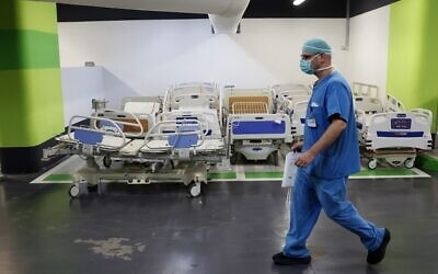 A medic works in the underground parking of Haifa's Rambam Health Care Campus, which was transformed into an intensive care facility for coronavirus patients, on September 23, 2020. (Jack Guez/AFP)