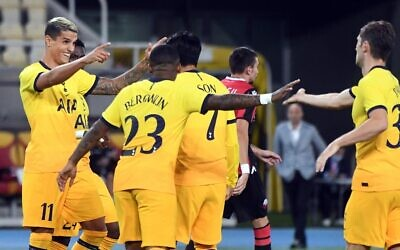 Erik Lamela (L) of Tottenham Hotspur celebrates with teammates after scoring a goal during the UEFA Europa League qualifying round match between Shkendija and Tottenham Hotspur at Philip II Arena in Skopje, Macedonia, on September 24, 2020. (Robert Atanasovski/AFP)