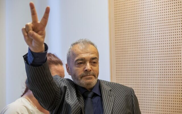 Walid Abdulrahman Abu Zayed flashes a victory sign during an extradition hearing at the Oslo District Court on September 25, 2020. (Terje Bendiksby/NTB/AFP)