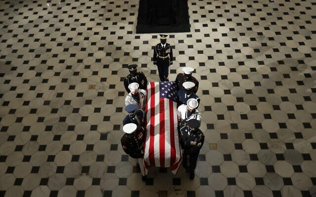 The flag-draped casket of the late Associate Justice Ruth Bader Ginsburg leaves the Statuary Hall of the US Capitol, September 25, 2020 in Washington, DC. (Chip Somodevilla / POOL / AFP)