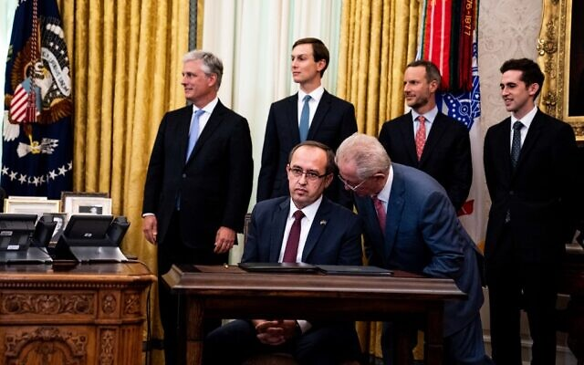 Prime Minister of Kosovo Avdullah Hoti sits at a desk as he attends a signing ceremony and meeting with US President Donald Trump and the President of Serbia Aleksandar Vucic in the Oval Office of the White House on September 4, 2020 in Washington, DC. (Anna Moneymaker-Pool/Getty Images/AFP)