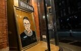 A portrait of US Supreme Court Justice Ruth Bader Ginsburg is displayed at a storefront on September 19, 2020, in New York, New York. (Jeenah Moon/Getty Images/AFP)