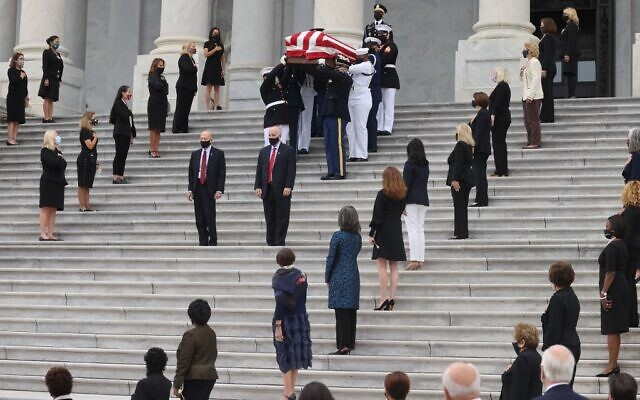 The casket of the late Supreme Court Associate Justice Ruth Bader Ginsburg is carried following ceremonies honoring Ginsburg at the U.S. Capitol, where she will lie in state in Statuary Hall on September 25, 2020 in Washington, DC. (Jonathan Ernst - Pool/Getty Images/AFP)