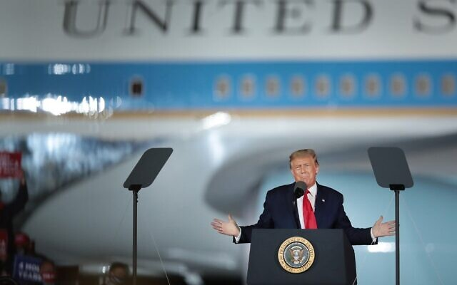 US President Donald Trump speaks to supporters at a rally with Air Force One in the background on September 10, 2020 in Freeland, Michigan. (Scott Olson/Getty Images/AFP)