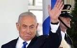 Prime Minister Benjamin Netanyahu waves as he arrives at the West Wing of the White House, September 15, 2020, in Washington, DC. (Alex Wong/Getty Images/AFP)