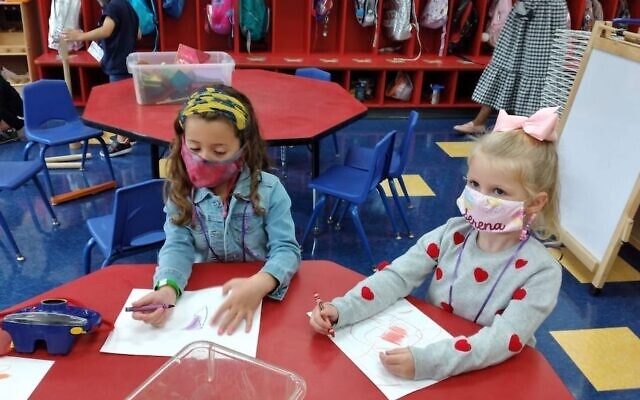 Kindergartners at the Moriah School in Englewood, New Jersey, one of seven Bergen County schools to urge families to abide by school guidelines outside of school. (Courtesy of the Moriah School via JTA)