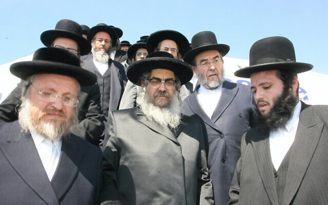 Rabbi Aaron Teitelbaum (center), the head of the Satmar Hasidic group, arrives at Ben Gurion Airport in August 2007. (Shooki Lerer/AFP via Getty Images/via JTA)
