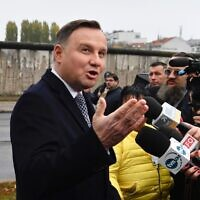 President Andrzej Duda of Poland speaks to the media in front of remains of the Berlin Wall, November 9, 2019. (John Macdougall/AFP via Getty Images)