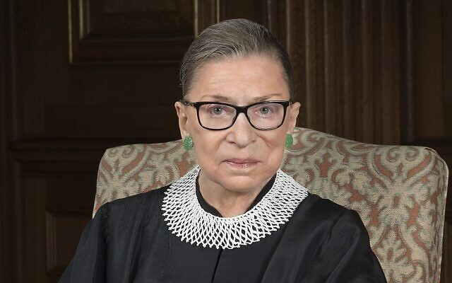The late US Supreme Court Justice Ruth Bader Ginsburg, in her signature lace jabot, one of which was donated by Ginsburg before her death to Tel Aviv's Museum of the Jewish People (Courtesy Supreme Court of the United States)