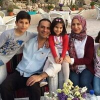 This undated 2018 photo shows Dr. Mohammed Ayesh and his family in Gaza. (Ayesh family via AP)