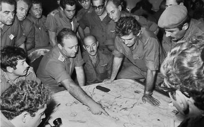 Top IDF officers look at a map during the Yom Kippur War in October 1973. (Israel Defense Forces/Defense Ministry Archives)