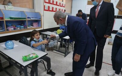Palestinian Authority Prime Minister Mohammad Shtayyeh visits an elementary school in Ramallah, on September 6, 2020. (WAFA)