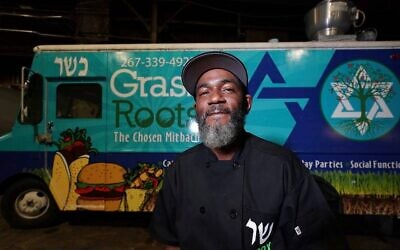 Troy Harris in front of his Grassroots kosher food truck. (Joseph Kaczmarek vis JTA)