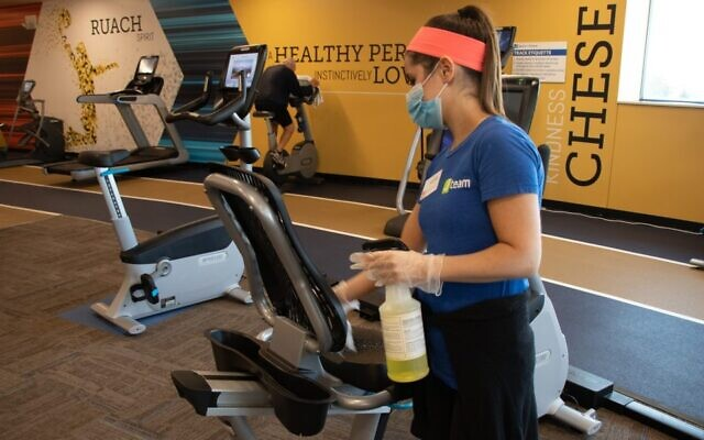 At the JCC in Overland Park, Kan., gym equipment is cleaned between uses to limit the possibility of coronavirus infection. (Courtesy of JFGKC via JTA)