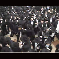 Worshipers dance late into the night at Chabad headquarters at 770 Eastern Parkway in Brooklyn after Selichot services early on Sunday, September 13, 2020. (Screenshot from livestream/via JTA)