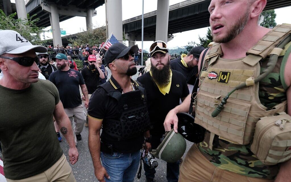 Proud Boys wait to get into vehicles after marching across the Hawthorne Bridge in Portland, Oregon, Aug. 17, 2019. (Alex Milan Tracy/Anadolu Agency via Getty Images, JTA)