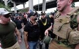 Proud Boys wait to get into vehicles after marching across the Hawthorne Bridge in Portland, Oregon, Aug. 17, 2019. (Alex Milan Tracy/Anadolu Agency via Getty Images via JTA)