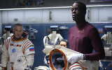 Ato Essandoh, right, as Kwesi Weisberg-Annan in Netflix's space drama 'Away.' (Diyah Pera/Netflix/via JTA)
