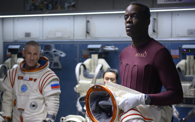 Ato Essandoh, right, as Kwesi Weisberg-Annan in Netflix's space drama 'Away.' (Diyah Pera/Netflix/via JTA)