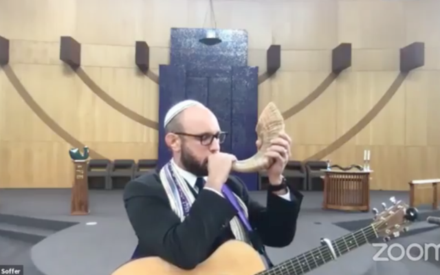 Rabbi Matt Soffer blows the shofar in remembrance of Ruth Bader Ginsburg, Sept. 19, 2020. (Screen capture/Facebook via JTA)