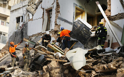 Chilean and Lebanese rescuers search in the rubble of a building that was collapsed in last month's massive explosion,  after getting signals there may be a survivor under the rubble, in Beirut, Lebanon on September 3, 2020. (AP/Bilal Hussein)