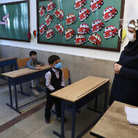 Students and their teacher attend class after the opening ceremony of the Hashtroudi school in Tehran, Iran, September 5, 2020. (AP Photo/Vahid Salemi)