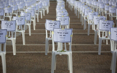 One thousand chairs are placed at Rabin Square in Tel Aviv to symbolize the deaths from the coronavirus pandemic, on Monday, September 7, 2020. (AP Photo/Sebastian Scheiner)