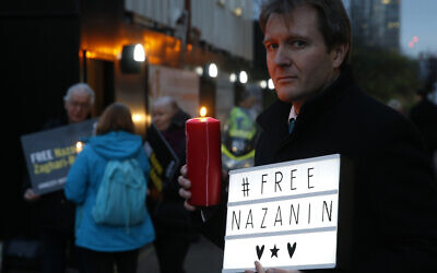 Richard Ratcliffe husband of imprisoned British-Iranian dual national Nazanin Zaghari-Ratcliffe, poses during an Amnesty International-led vigil outside the Iranian Embassy in London, January 16, 2017.  (AP Photo/Alastair Grant, File)