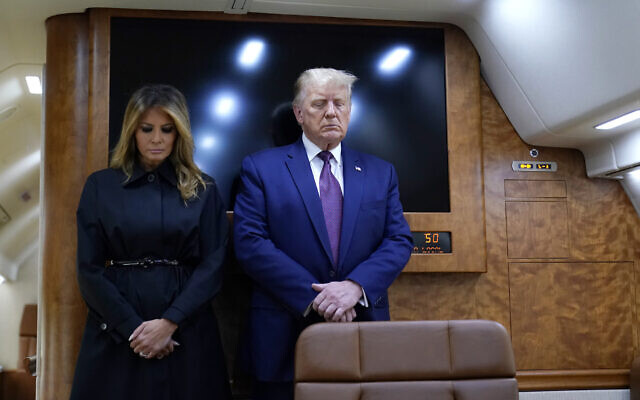 US President Donald Trump and first lady Melania Trump pause for a moment of silence on Air Force One as he arrives at the airport in Johnstown, Pennsylvania, on his way to speak at the Flight 93 National Memorial, September 11, 2020, in Shanksville, Pennsylvania. (AP Photo/Alex Brandon)