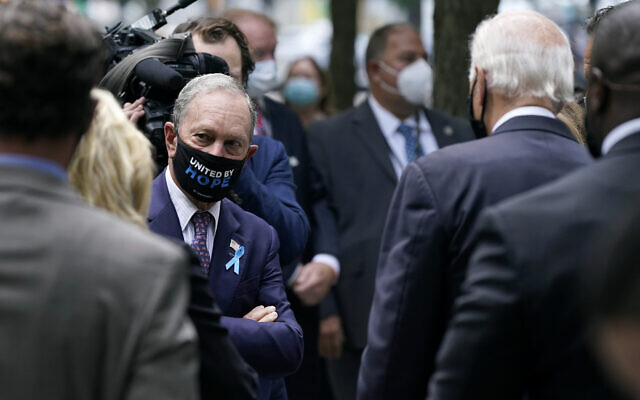 Former New York mayor Michael Bloomberg, left, visits with Democratic presidential candidate Joe Biden, at the National September 11 Memorial in New York, September 11, 2020, before a ceremony marking the 19th anniversary of the terrorist attacks. (AP Photo/Patrick Semansky)
