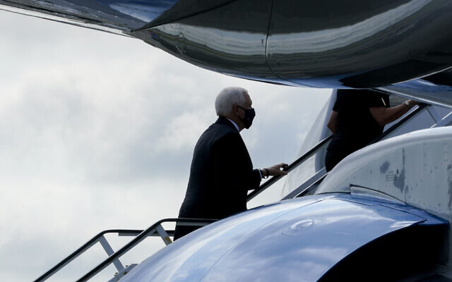 US Vice President Mike Pence boards Air Force Two after attending a ceremony marking the 19th anniversary of the 9/11 terrorist attacks at the National September 11 Memorial & Museum, September 11, 2020, in New York. (AP Photo/Mary Altaffer)