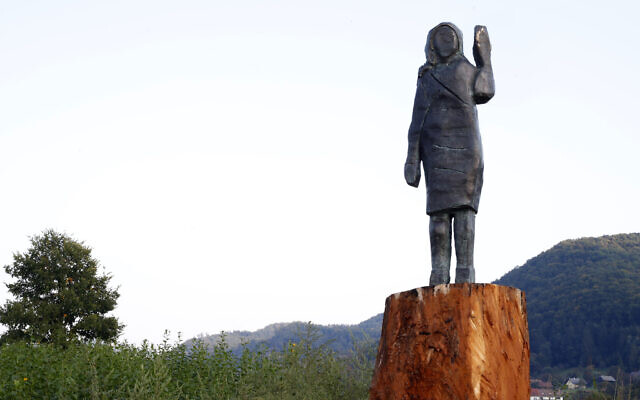 A bronze statue representing US First Lady Melania Trump made by Brad Downey, a Berlin-based US artist, is erected in her birthplace of Sevnica, Slovenia, September 15, 2020, after a previous one, made in wood, was set alight. (AP Photo)