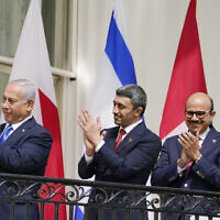 From left to right: Israeli Prime Minister Benjamin Netanyahu, United Arab Emirates Foreign Minister Abdullah bin Zayed al-Nahyan and Bahrain Foreign Minister Abdullatif al-Zayani stand on the Blue Room Balcony during the Abraham Accords signing ceremony on the South Lawn of the White House, Tuesday, Sept. 15, 2020, in Washington. (AP Photo/Alex Brandon)