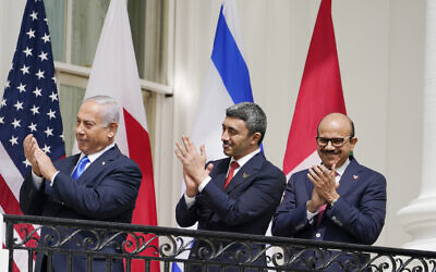 From left to right: Israeli Prime Minister Benjamin Netanyahu, United Arab Emirates Foreign Minister Abdullah bin Zayed al-Nahyan and Bahrain Foreign Minister Abdullatif al-Zayani stand on the Blue Room Balcony during the Abraham Accords signing ceremony on the South Lawn of the White House, September 15, 2020, in Washington. (Alex Brandon/AP)